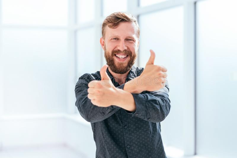 Happy businessman showing thumbs up. photo with copy space stock photos