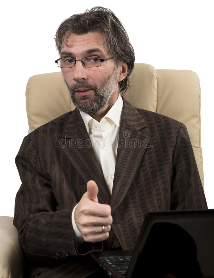 Happy businessman sitting in chair with notebook. Happy businessman in suit sitting in chair with notebook isolated white stock photos