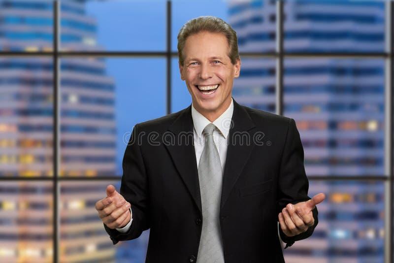 Happy businessman on skyscraper background. stock photo