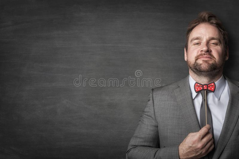 Happy businessman in a suit royalty free stock images