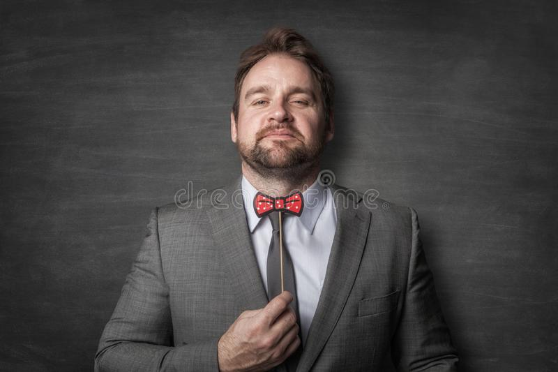 Happy businessman in a suit stock photo