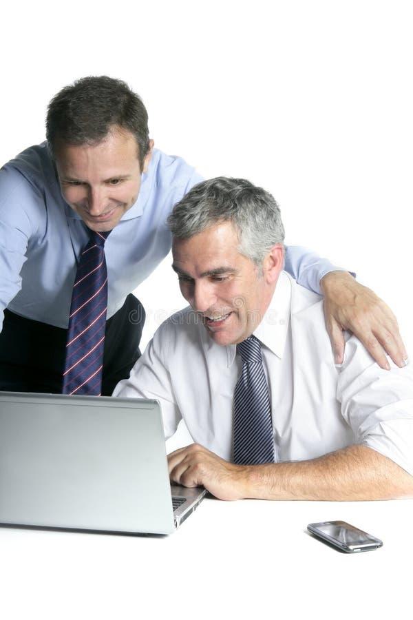 Happy businessman team on computer good sales stock photo
