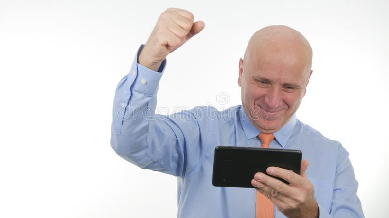 Happy Businessman Use Tablet Read Good Financial News Make Victory Hand Gestures. Happy Enthusiastic Businessman Use Tablet Read Good Financial News Make Victory royalty free stock photography