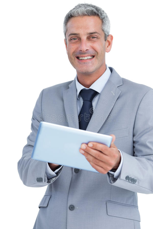 Download Happy Businessman Using Tablet Pc Looking At Camera Stock Photo - Image: 32515120