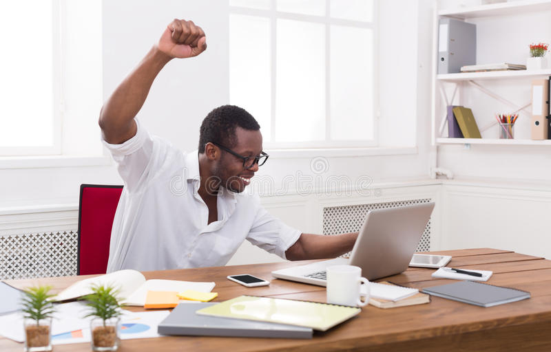 Happy businessman win. Winner, black man in office royalty free stock images