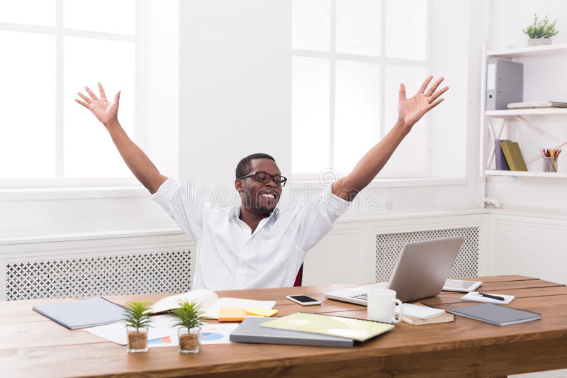 Happy businessman win. Winner, black man in office. Happy excited businessman celebrate. Winner, black man in office with laptop royalty free stock images