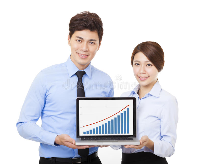 Happy businessman and woman showing laptop with graph. Happy business men and women showing laptop with graph stock photography