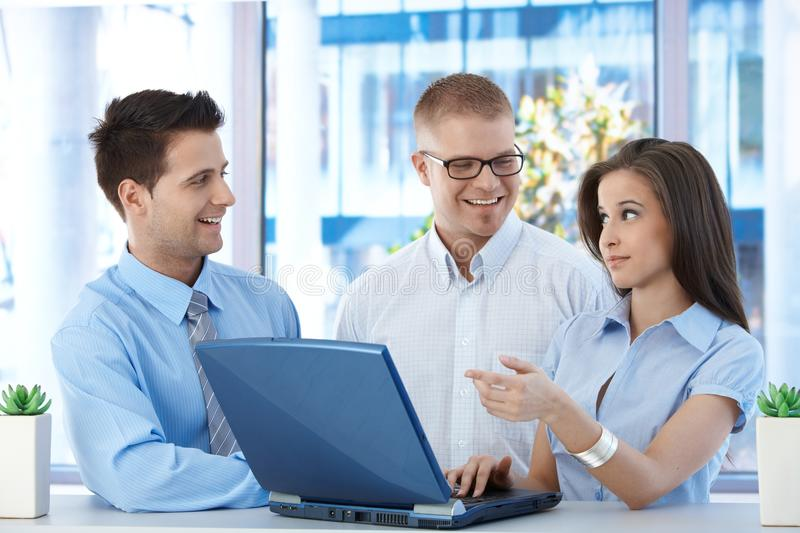 Happy businesspeople at work royalty free stock image