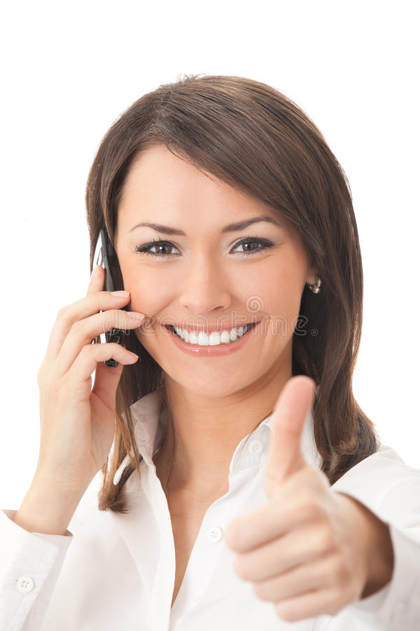 Happy businesswoman. With phone and thumbs up gesture, isolated royalty free stock image