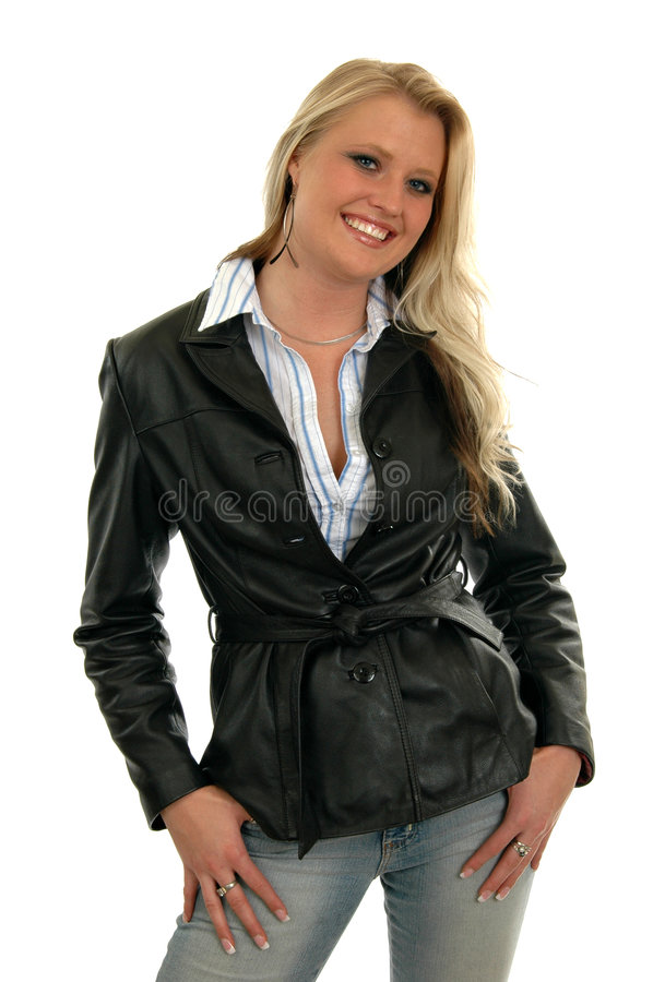 Happy Businesswoman. A beautiful businesswoman in a black leather jacket royalty free stock photo