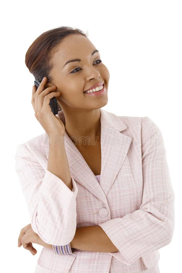Happy businesswoman on call. Portrait of happy businesswoman on mobile phone call, smiling royalty free stock photos