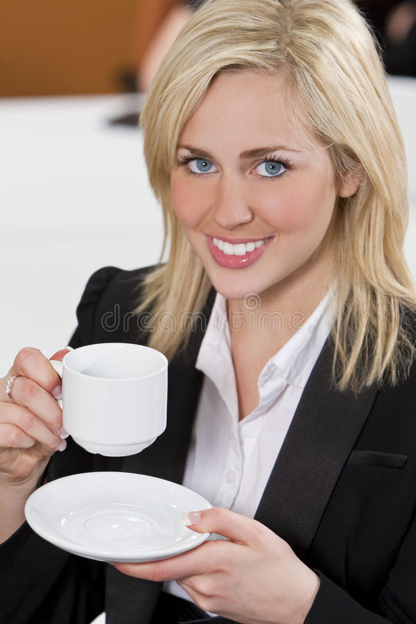 Download Happy Businesswoman Drinking Coffee In An Office Stock Image - Image: 12696269