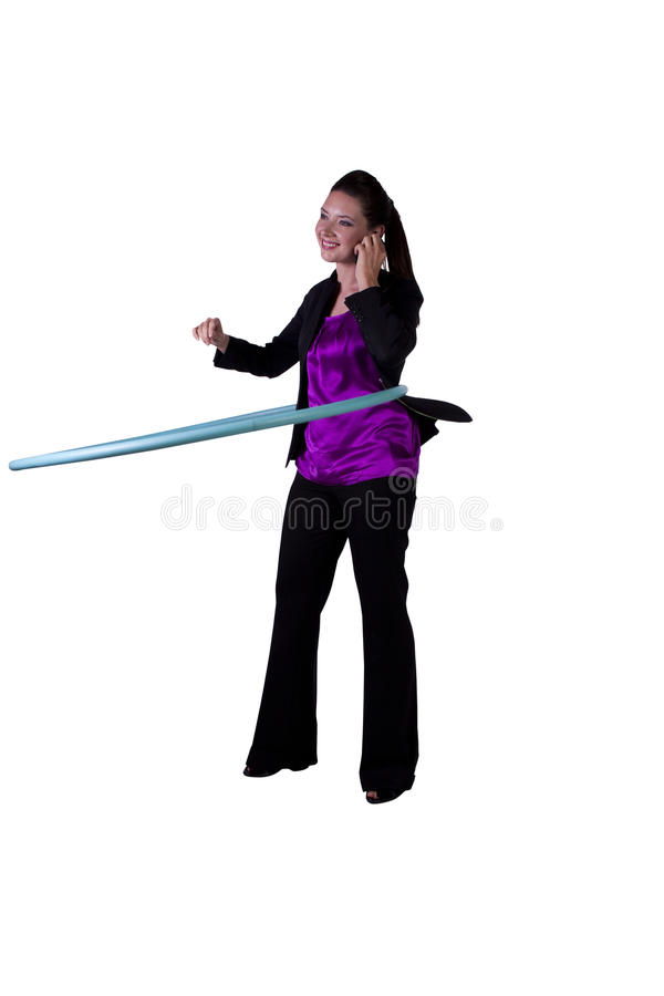 A happy businesswoman exercising with a hula- hoop. Businesswoman relaxing in the office by hula-hooping - stress-free work environment stock images