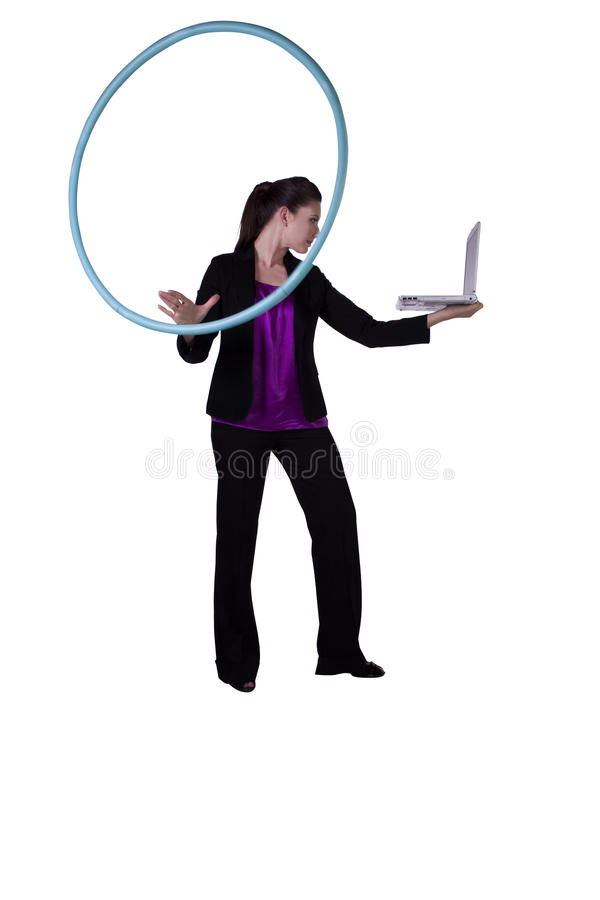 A happy businesswoman exercising with a hula- hoop. Businesswoman relaxing in the office by hula-hooping - stress-free work environment royalty free stock images
