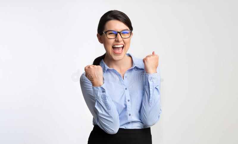 Happy Businesswoman Gesturing Yes Celebrating Success, White Background royalty free stock images
