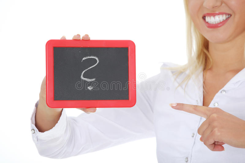 Happy businesswoman holding black board royalty free stock image