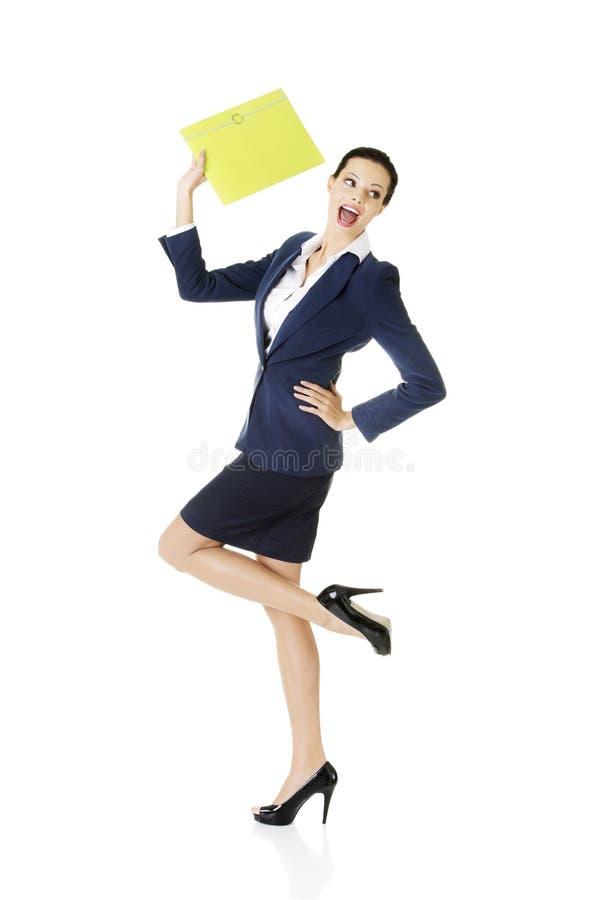Happy businesswoman holding portfolio royalty free stock photography