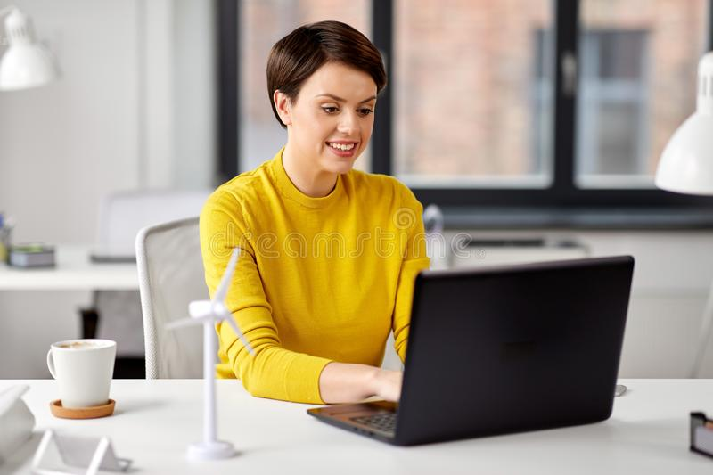Happy businesswoman with laptop working at office royalty free stock photo