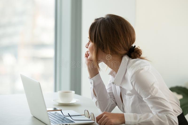 Smiling businesswoman looking far away dreaming about future suc stock images