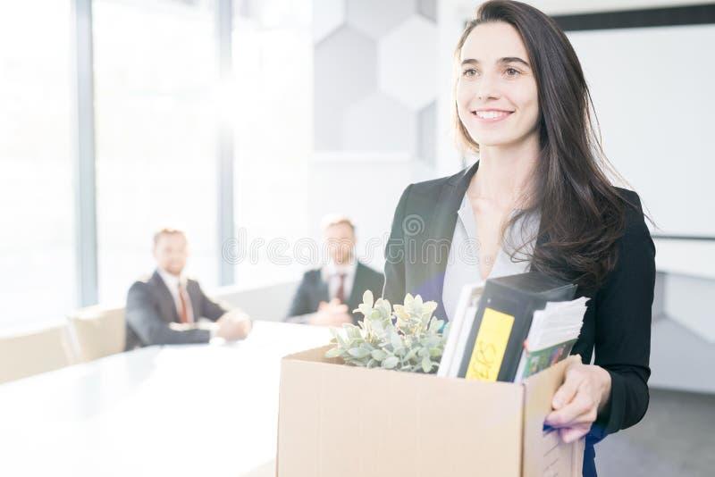 Happy Businesswoman Quitting Job stock photography