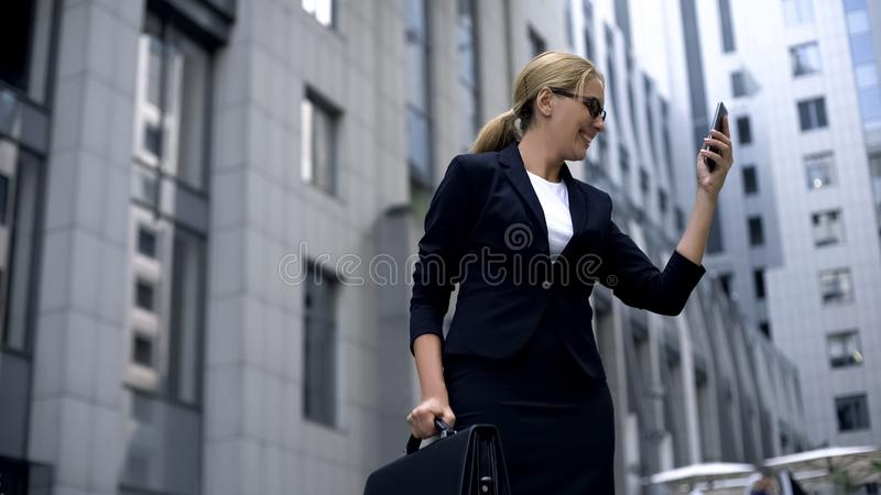 Happy businesswoman rejoicing sms with good news, making profitable investment. Stock photo royalty free stock photography