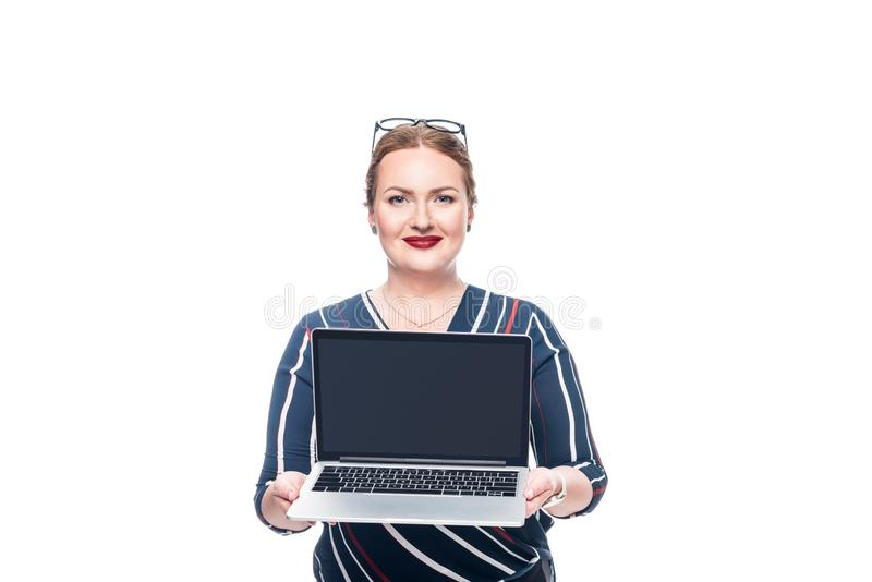 happy businesswoman showing laptop with blank screen stock photography