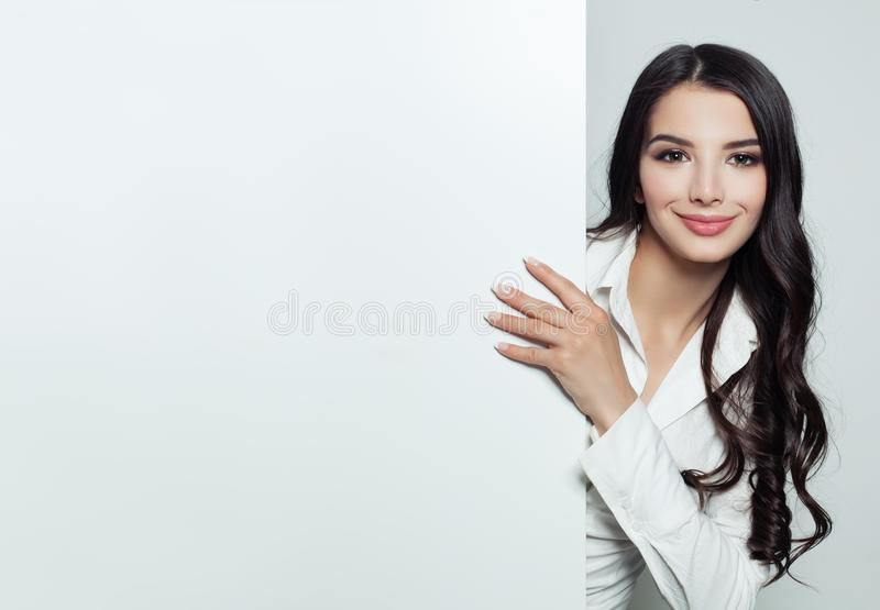 Happy Businesswoman showing white empty banner stock images