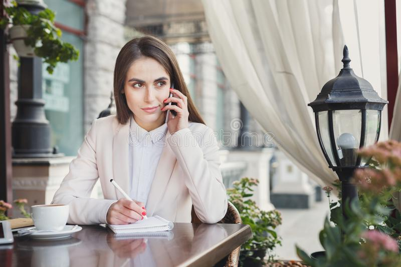 Young businesswoman talking on smartphone stock image