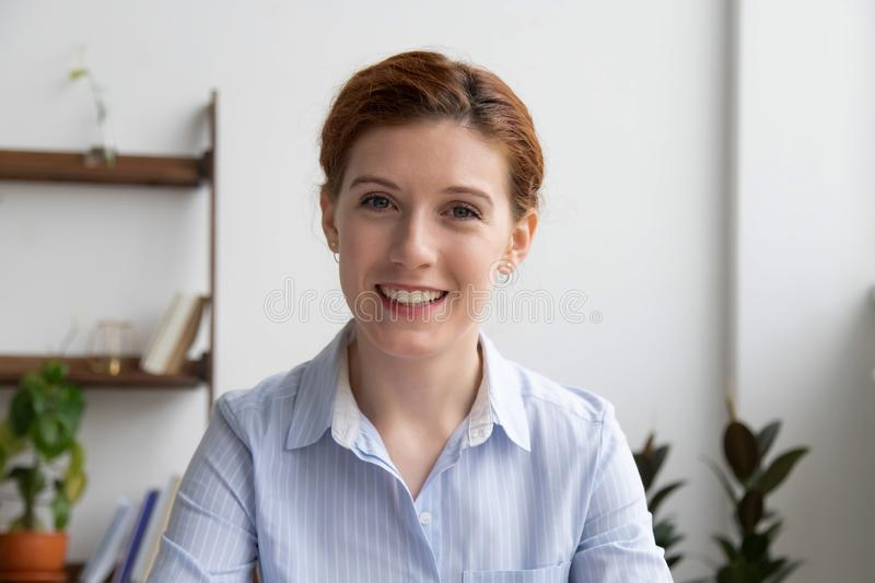 Happy businesswoman talking by video conference call looking at webcam. Happy business woman talking by video conference call to virtual distant client having stock images