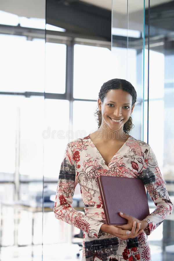 Free Happy Businesswoman With File Folder In Office Royalty Free Stock Photography - 33861857