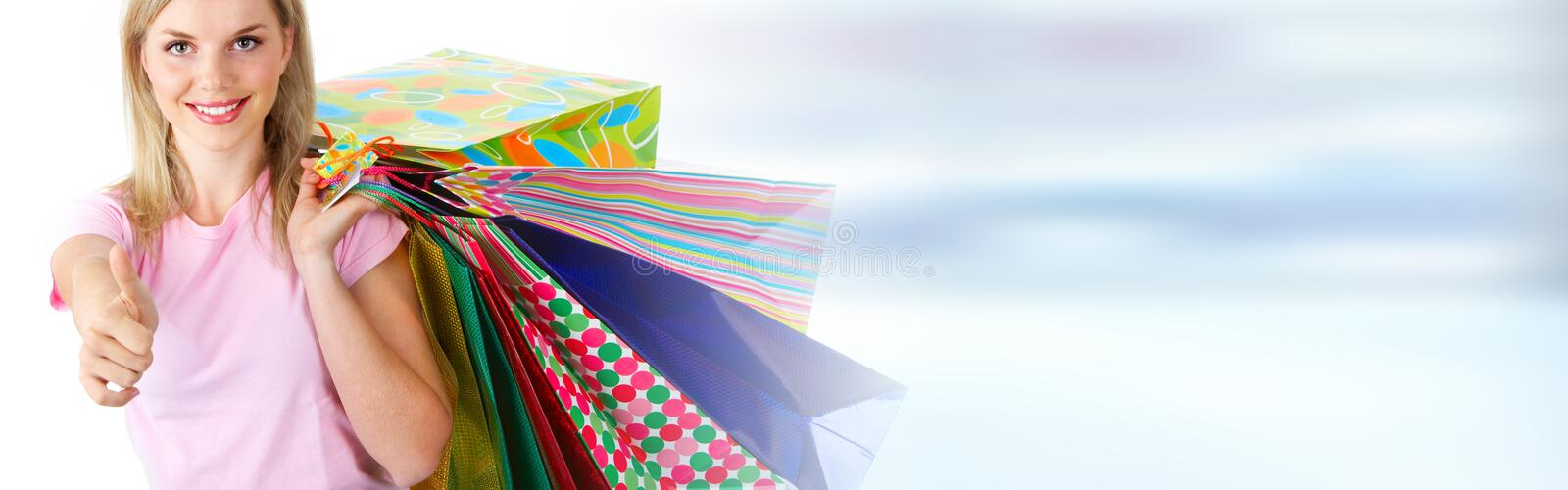 Happy buyer girl with bags stock photography