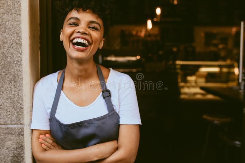 Happy cafe owner stock images