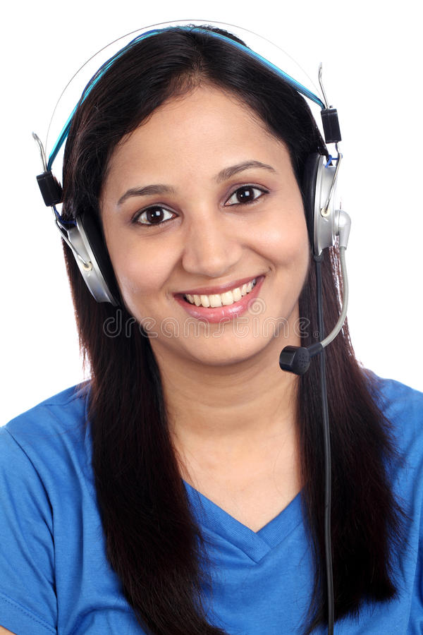 Happy call center girl. Happy young Indian call center girl against white background stock photography