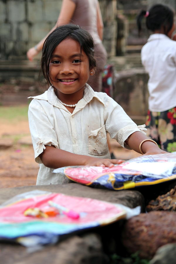Happy Cambodian Girl. Portrait of a happy Cambodian girl smiling with her new school bag and stationery donated by a tourist at Angkor Wat, Siem Reap, Cambodia royalty free stock images