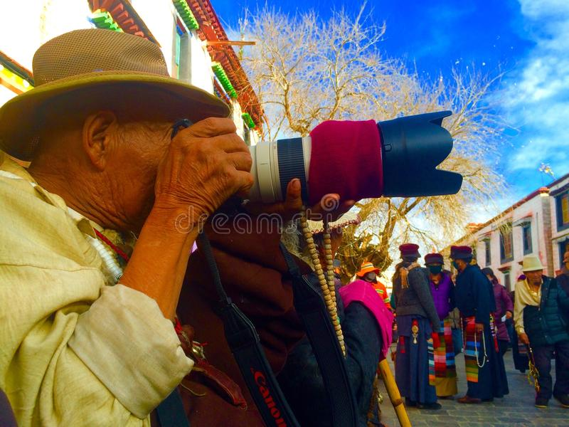 happy with the camera tibetan man royalty free stock photo