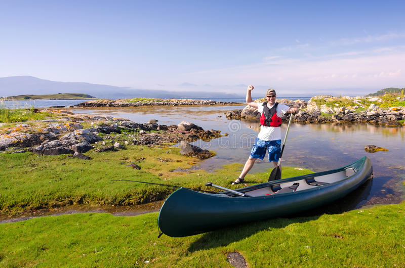 Happy canoe angler in wild nature stock image