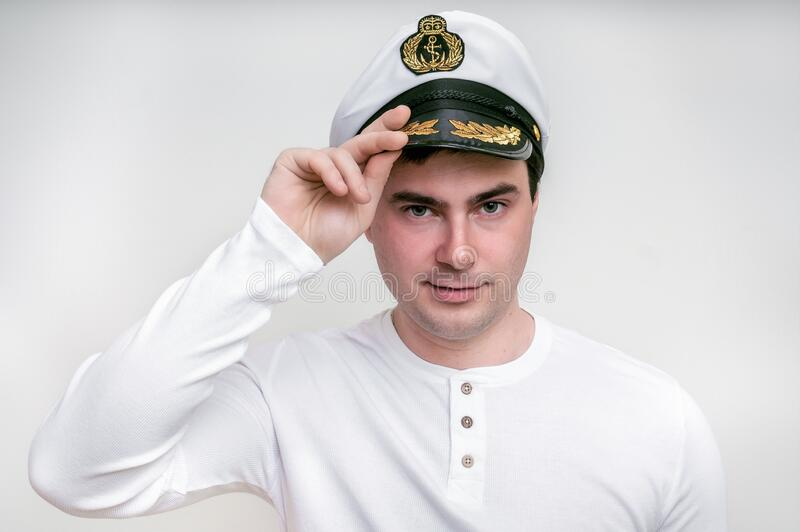 Captain with sailor cap isolated on white stock photos