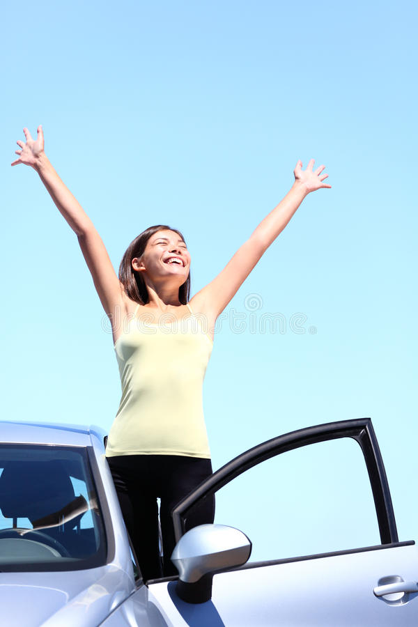 Happy car driver woman on summer road trip