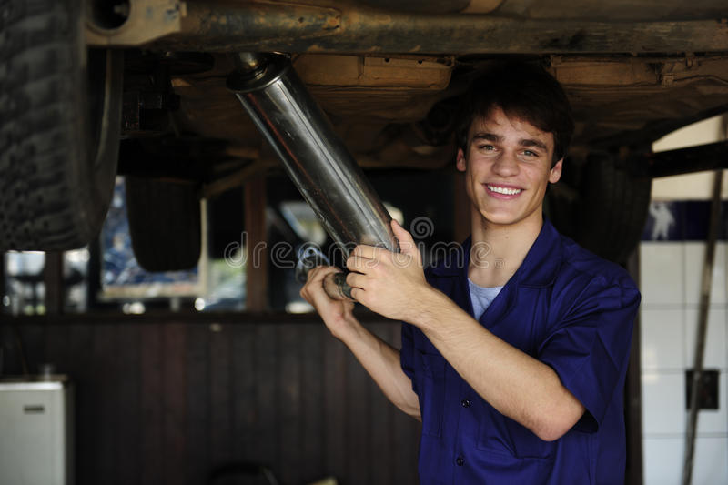 Happy Car Mechanic At Work Royalty Free Stock Photography