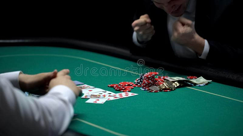 Happy casino player winning chips and money at poker game, fortunate businessman. Stock photo stock images