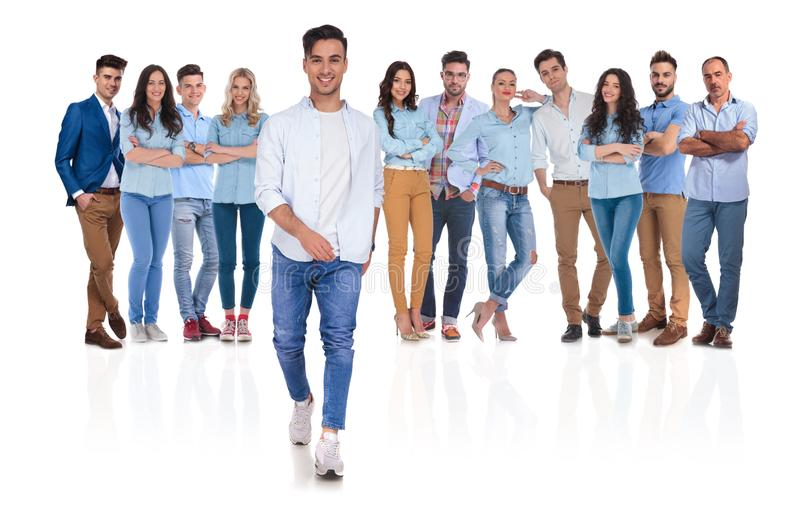 Happy casual group leader stepping in front royalty free stock images