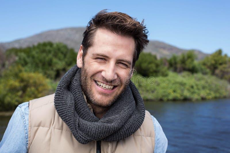 Happy casual man at a lake stock photo