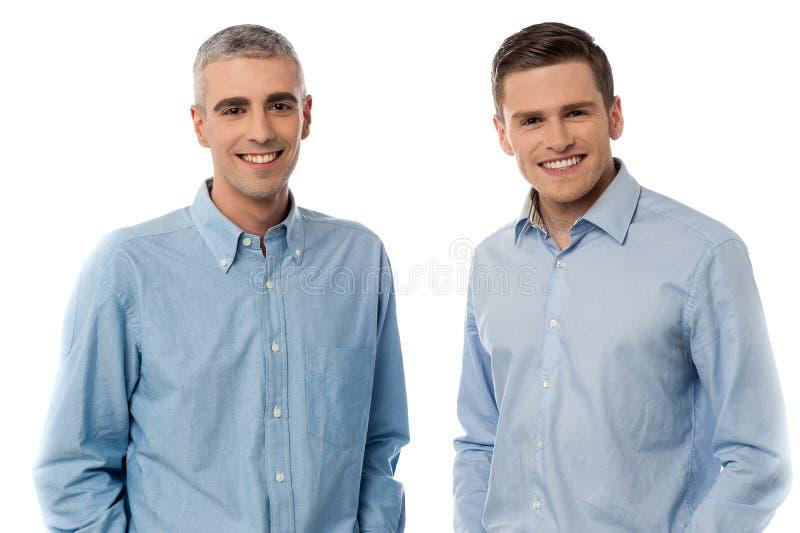 Happy casual men posing royalty free stock photos