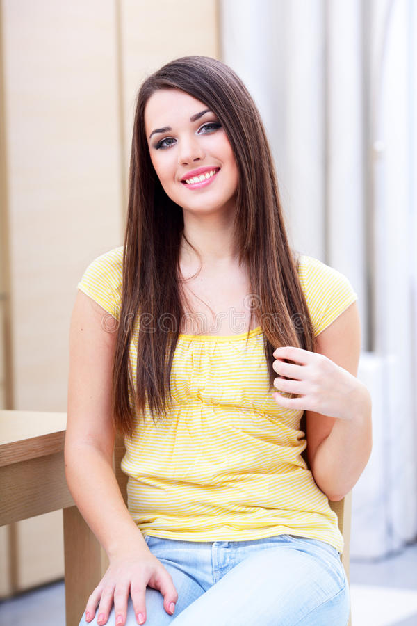 Happy casual woman resting at home royalty free stock photo