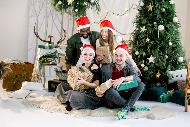 Happy Caucasian boy and girls and African boy smiling and having fun on Christmas celebration. Happy Caucasian boy and girls and African boy smiling and having stock photos