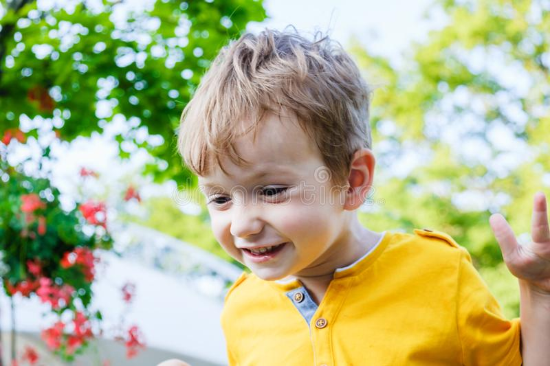 Happy caucasian boy smiling enjoying life. Portrait of young boy in nature, park or outdoors. Concept of happy family royalty free stock photo