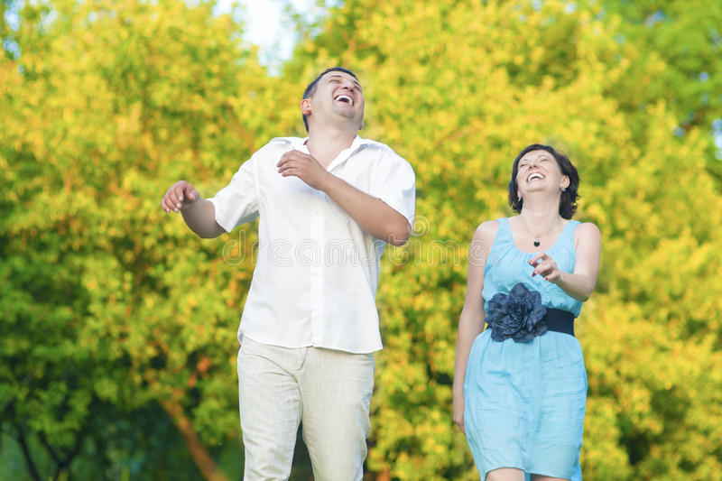 Happy caucasian Couple Having Good Time Outdoors Laughing. Mature Couple Relationships Concepts and Ideas.Happy caucasian Couple Having Good Time Outdoors stock images