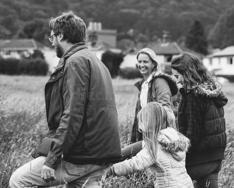 Happy caucasian family in field grayscale royalty free stock images