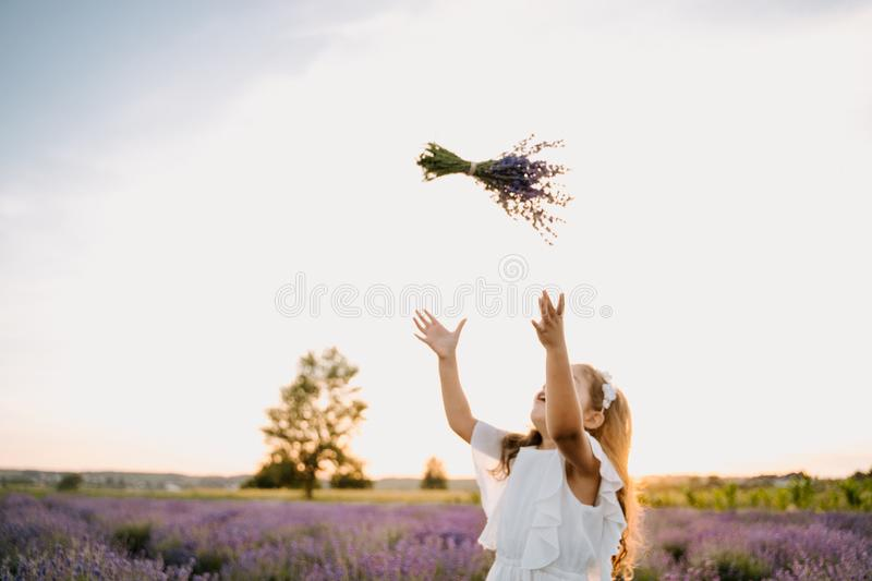 Happy Caucasian Girl with Violet Lavender Bouquet royalty free stock photos