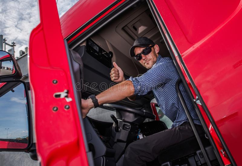 Truck Driver Thumb Up. Happy Caucasian Semi Truck Driver Showing Thumb Up. Trucking Theme. Transport Industry royalty free stock photo